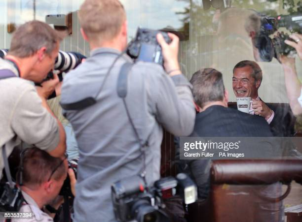 Ukip party leader Nigel Farage enjoys a coffee at the Castlemayne Pub during a visit to Basildon Essex as his party make gains across the country...