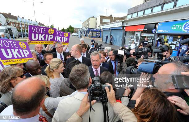 Ukip party leader Nigel Farage is surrounded by the media during a visit to South Ockendon Essex as his party make gains across the country following...