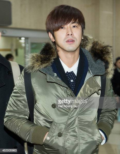 Know of South Korean boy band TVXQ is seen upon arrival at the Gimpo International Airport on November 25 2013 in Seoul South Korea