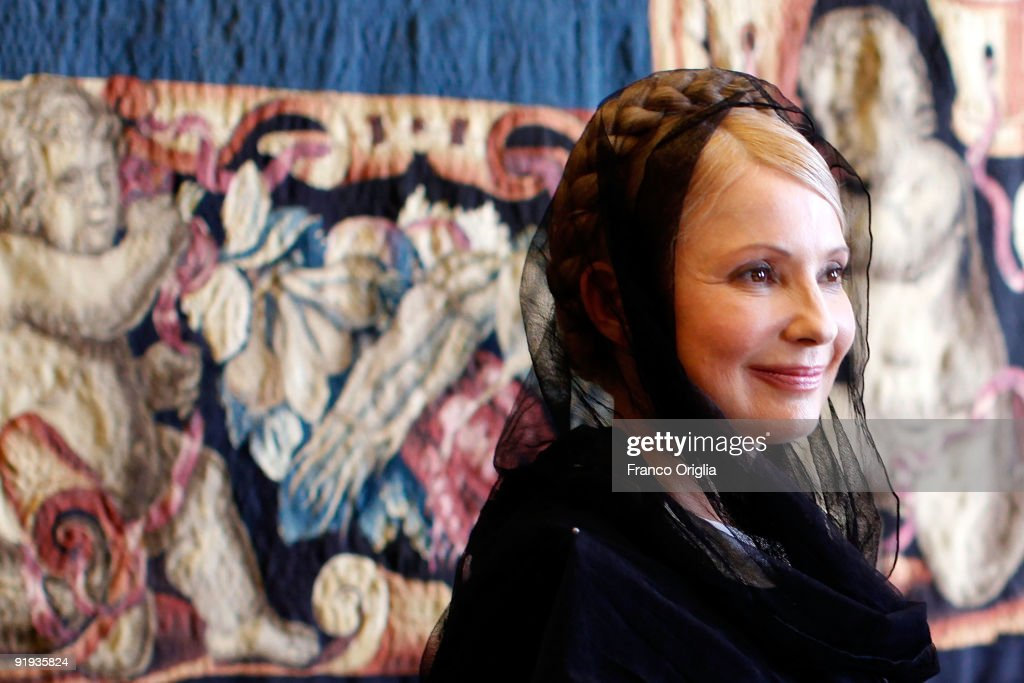 Ukraina Prime Minister <a gi-track='captionPersonalityLinkClicked' href=/galleries/search?phrase=Yulia+Tymoshenko&family=editorial&specificpeople=546280 ng-click='$event.stopPropagation()'>Yulia Tymoshenko</a> smiles as she attends a meeting with Vatican secretary of State Cardinal Tarcisio Bertone on October 16, 2009 in Vatican City, Vatican.