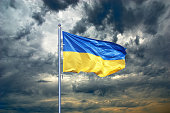 Ukraine flag. Ukrainian flag on black storm cloud sky. stormy weather