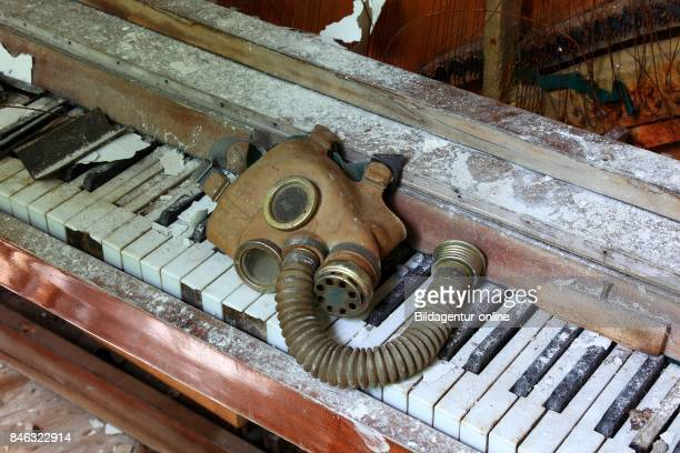 Ukraine In the Restricted and Uninhabitable 30 Kilometer Zone Around the Chernobyl Power Plant and the Pripyat Labor Camp Gas Mask On A Piano