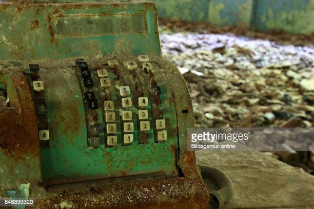 Ukraine In the Restricted and Uninhabitable 30 Kilometer Zone Around the Chernobyl Power Plant and the Pripyat Labor Camp Gasmask and Cash Register