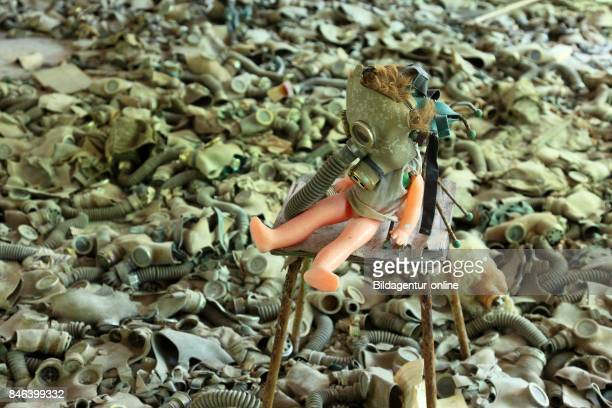 Ukraine In the Restricted and Uninhabitable 30 Kilometer Zone Around the Chernobyl Power Plant and the Pripyat Labor Camp Gasmask and Doll