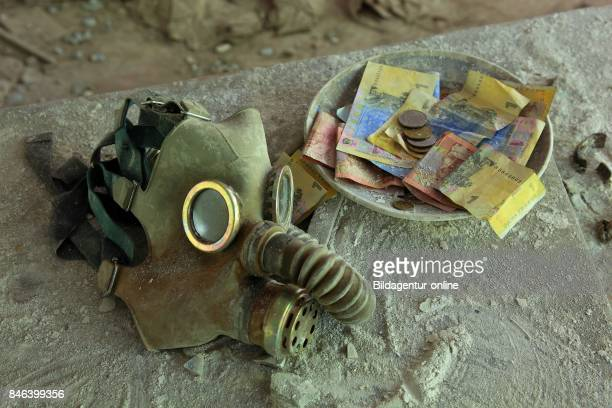 Ukraine In the Restricted and Uninhabitable 30 Kilometer Zone Around the Chernobyl Power Plant and the Pripyat Labor Camp Plate With Money and Gasmask
