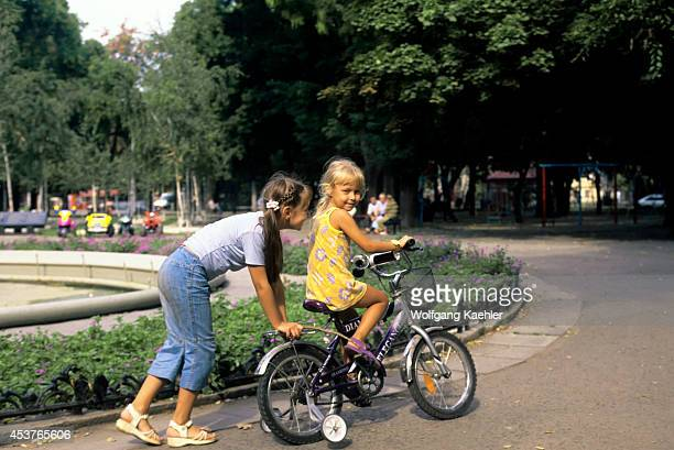Ukraine Odesa Local Girls With Bicycle