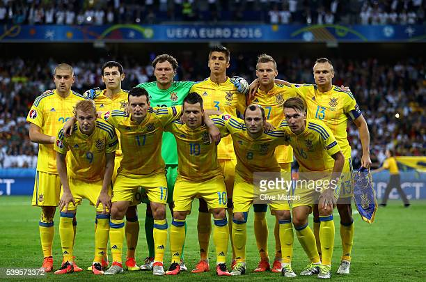 Ukraine players line up for the team photos prior to the UEFA EURO 2016 Group C match between Germany and Ukraine at Stade PierreMauroy on June 12...