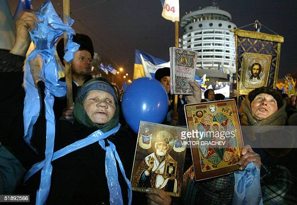 Supporters of Ukrainian proRussia Prime Minister and presidential candidate Viktor Yanukovich hold icons and shout slogans during a rally 24 December...