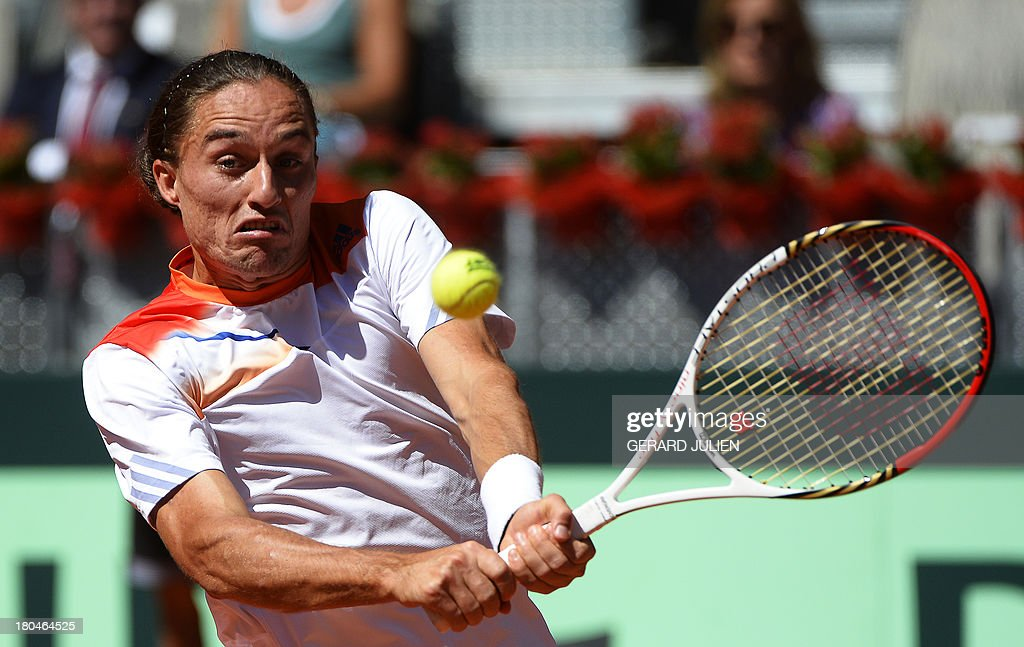 Ukraine's Alexander Dolgopolov returns the ball to Spain's Fernando Verdasco during the Davis Cup World Group play-off 2013 at the Caja Magica sports complex in Madrid on September 13, 2013. AFP PHOTO / GERARD JULIEN