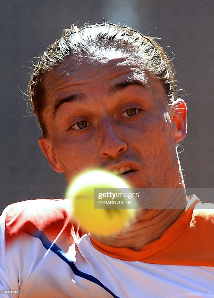 Ukraine's Alexander Dolgopolov returns the ball to Spain's Fernando Verdasco during the World Group Play-offs 2013 at the Caja Magica sports complex in Madrid on September 13, 2013. Winning nations qualify for the World Group in 2014.