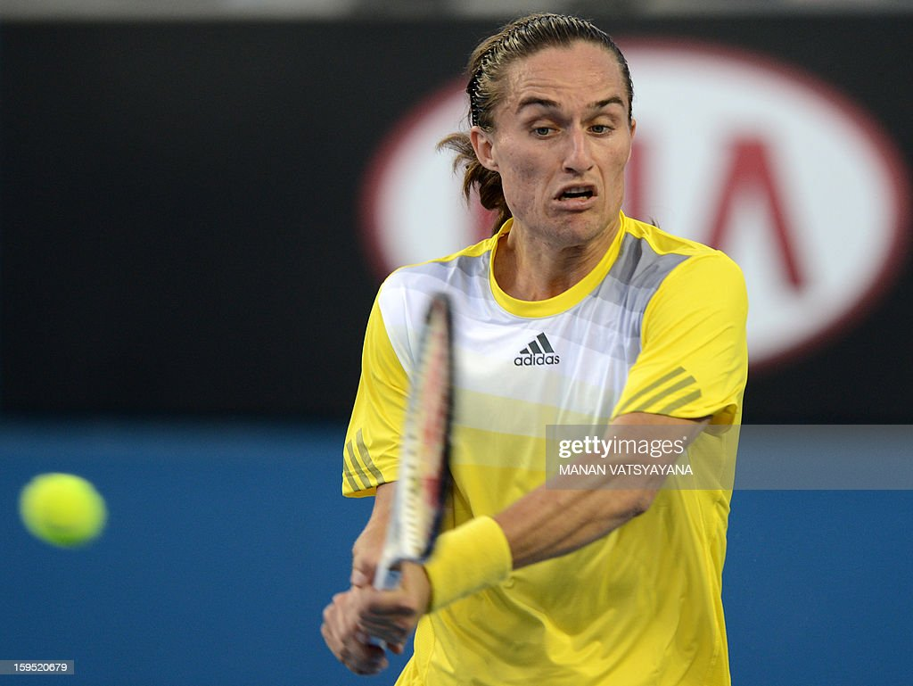 Ukraine's Alexandr Dolgopolov plays a return during his men's singles match against France's Gael Monfils on the second day of the Australian Open tennis tournament in Melbourne on January 15, 2013. AFP PHOTO/MANAN VATSYAYANA IMAGE STRICTLY RESTRICTED TO EDITORIAL USE - STRICTLY NO COMMERCIAL USE
