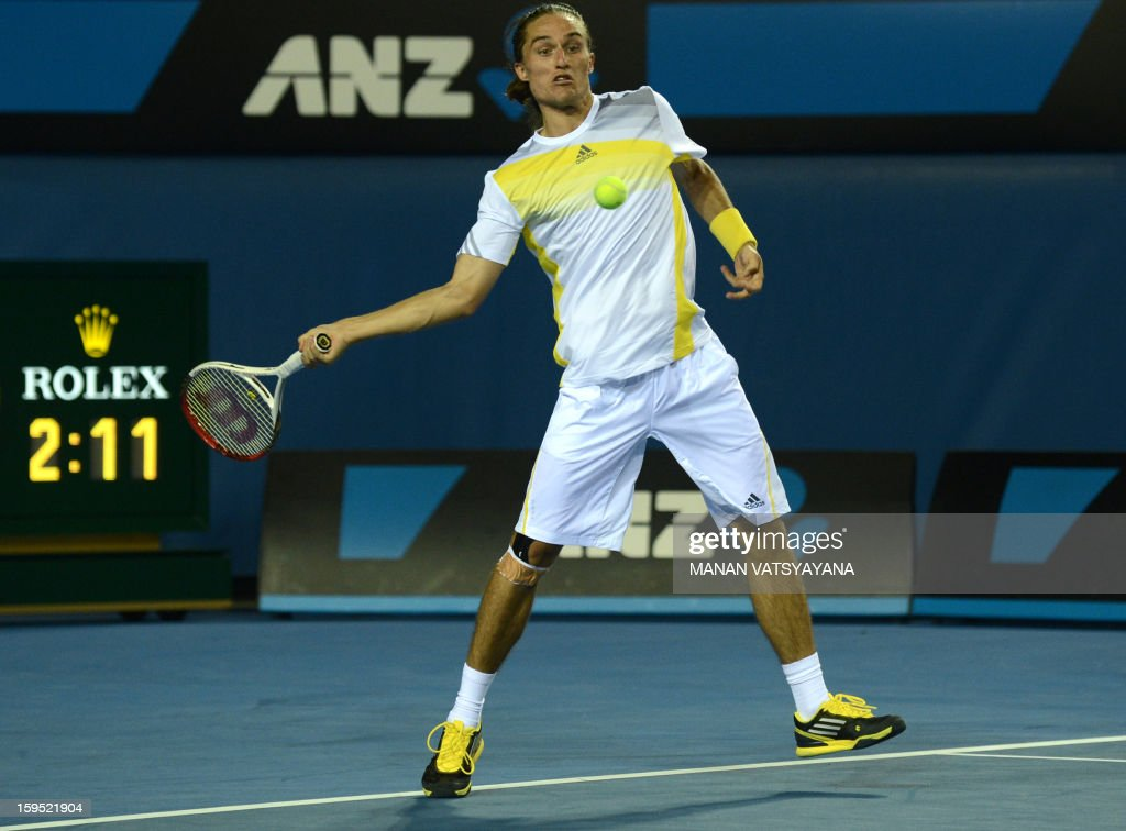 Ukraine's Alexandr Dolgopolov plays a return during his men's singles match against France's Gael Monfils on the second day of the Australian Open tennis tournament in Melbourne on January 15, 2013.