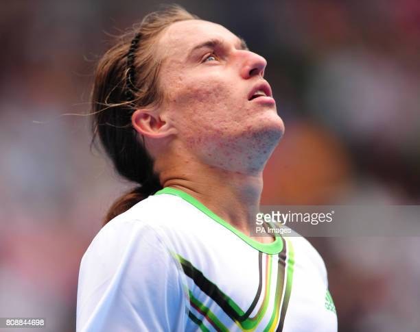 Ukraine's Alexandr Dolgopolov reacts to losing the second set during day ten of the 2011 Australian Open at Melbourne Park in Melbourne Australia