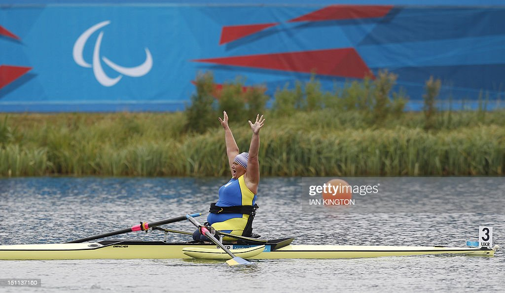 Ukraine's Alla Lysenko celebrates winning the AS women single sculls Final A during the London 2012 Paralympic Games in Eton Dorney on September 2, 2012.