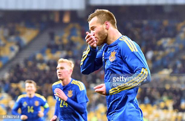Ukraine's Andriy Yarmolenko celebrates after scoring during the international friendly football match between Ukraine and Wales on March 28 at...