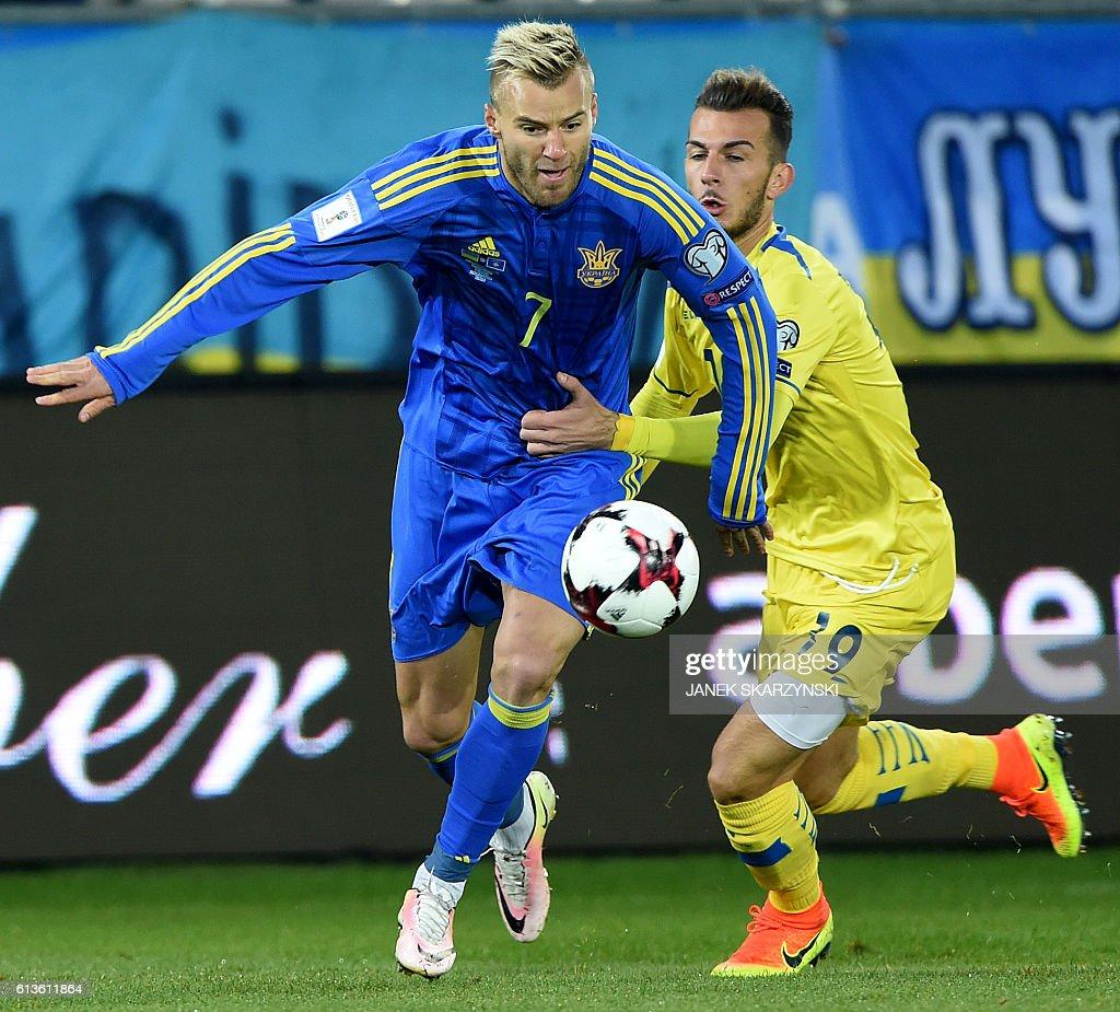 Ukraine s Andriy Yarmolenko L vies for a ball with Kosovo s