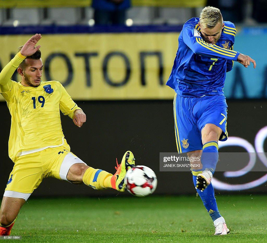 Ukraine s Andriy Yarmolenko R vies for a ball with Kosovo s