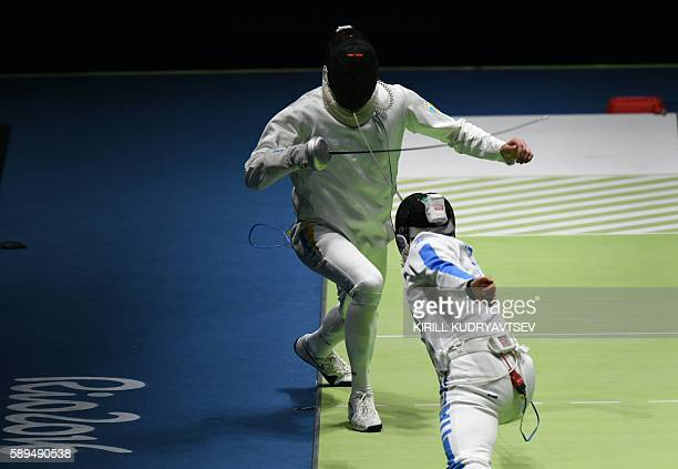 Ukraine's Bogdan Nikishin competes against Italy's Paolo Pizzo during the mens team epee semifinal bout between Italy and Ukraine as part of the...