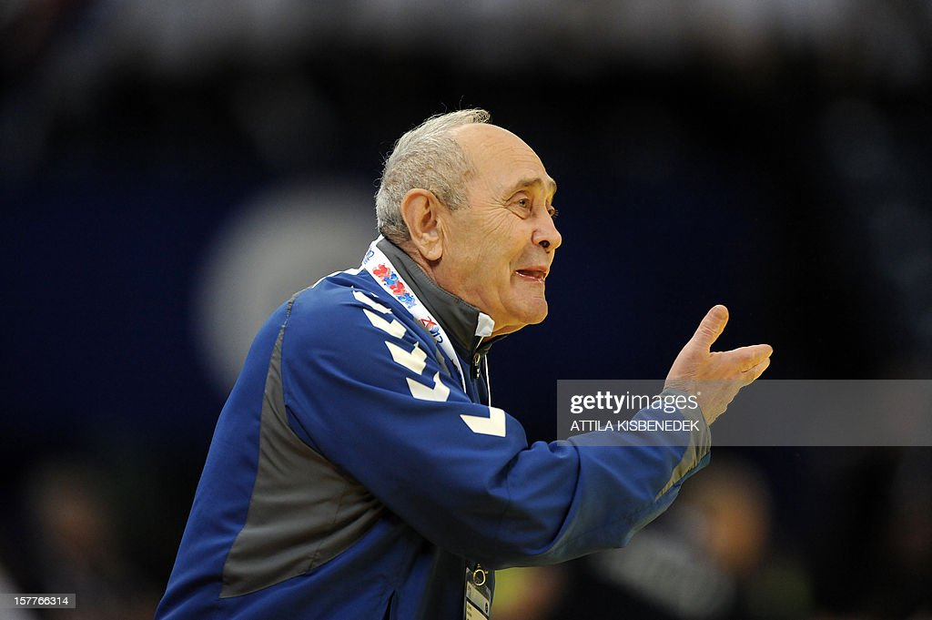 Ukraine's coach Leonid Ratner gestures during the 2012 EHF European Women's Handball Championship match against Serbia on December 6, 2012, at the Kombank Arena of Belgrade. The Serbian capital Belgrade hosts the preliminary round Group A matches including Czech Republic, Norway, Serbia and Ukraine.