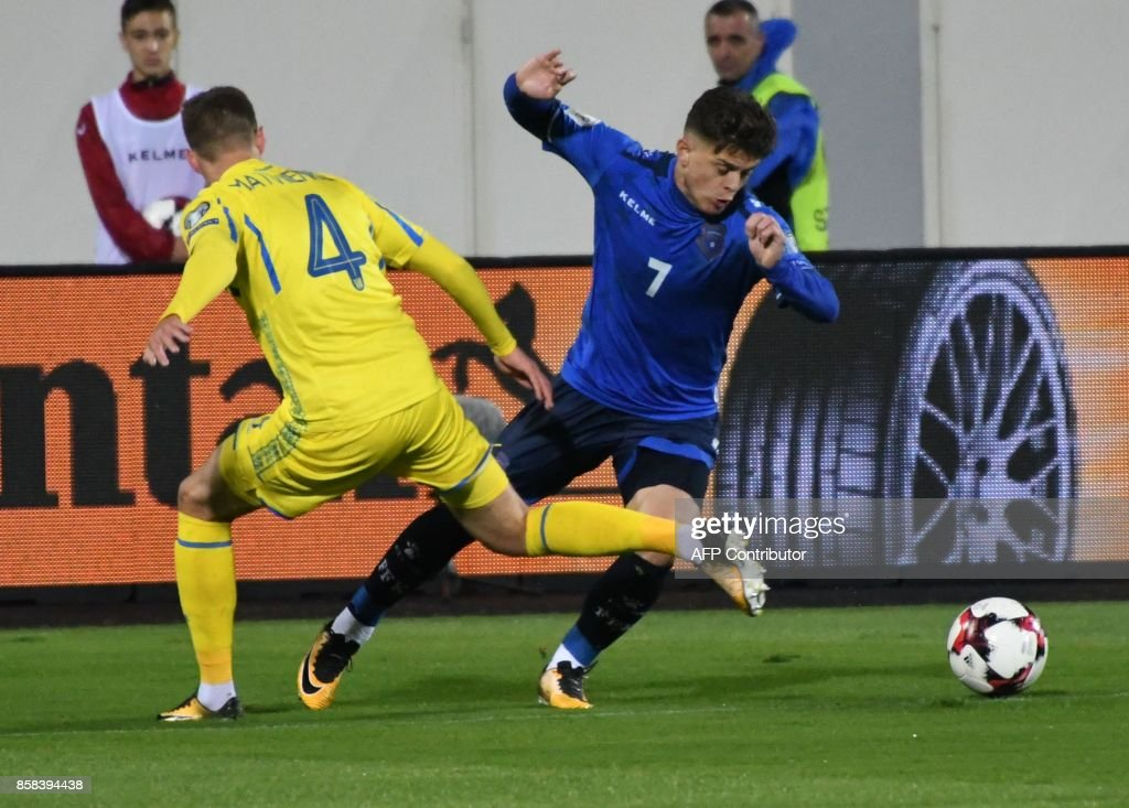Ukraine's defender Mykola Matviyenko (L) fights for the ball with Kosovo's midfielder Milot Rashica (R) during the FIFA World Cup 2018 qualification football match between Kosovo and Ukraine at The Loro Borici Stadium in Shkoder on October 6, 2017. / AFP PHOTO / Gent SHKULLAKU