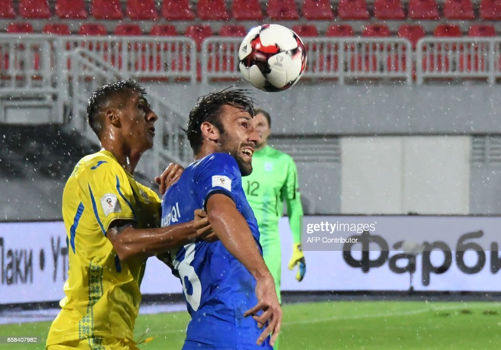 Ukraine's defender Yevhen Khacheridi (L) fights for the ball with Kosovo's forward Vedat Muriqi (R) during the FIFA World Cup 2018 qualification football match between Kosovo and Ukraine at The Loro Borici Stadium in Shkoder on October 6, 2017. / AFP PHOTO / Gent SHKULLAKU