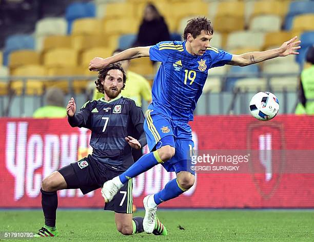 Ukraine's Denys Harmash fights for the ball with Wales' Joe Allen during the international friendly football match between Ukraine and Wales at the...