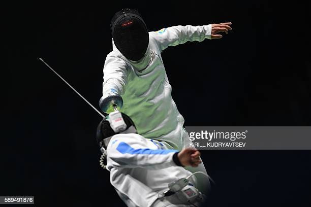 Ukraine's Dmytro Karyuchenko competes against Italy's Paolo Pizzo during the mens team epee semifinal bout between Italy and Ukraine as part of the...