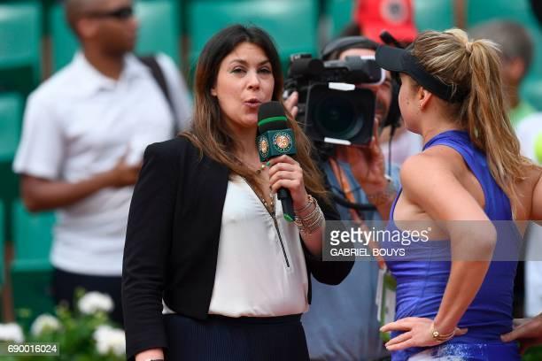 Ukraine's Elina Svitolina answers former tennis player Marion Bartoli's questions after she won against Kazakhstan's Yaroslava Shvedova during their...
