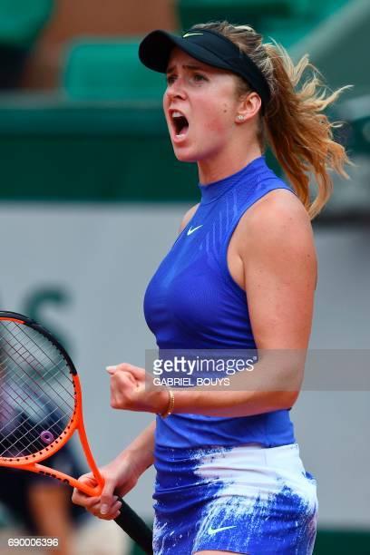 Ukraine's Elina Svitolina celebrates after winning against Kazakhstan's Yaroslava Shvedova during their tennis match at the Roland Garros 2017 French...