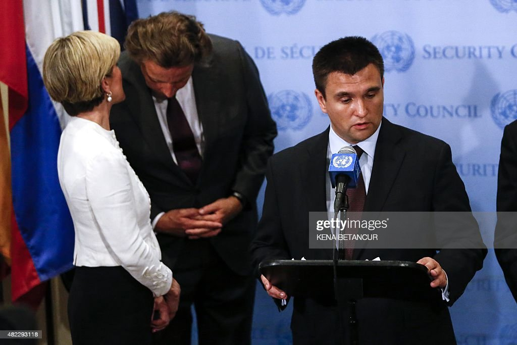 Ukraine's Foreign Minister <a gi-track='captionPersonalityLinkClicked' href=/galleries/search?phrase=Pavlo+Klimkin&family=editorial&specificpeople=12902005 ng-click='$event.stopPropagation()'>Pavlo Klimkin</a> speaks as Dutch Foreign Minister <a gi-track='captionPersonalityLinkClicked' href=/galleries/search?phrase=Bert+Koenders&family=editorial&specificpeople=2358914 ng-click='$event.stopPropagation()'>Bert Koenders</a> (C) and Australian Foreign Minister <a gi-track='captionPersonalityLinkClicked' href=/galleries/search?phrase=Julie+Bishop&family=editorial&specificpeople=1198450 ng-click='$event.stopPropagation()'>Julie Bishop</a> talk to each other in the background during a press conference after the Security council meeting at the United Nations Headquarters in New York on July 29, 2015.