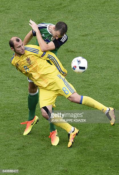Ukraine's forward Roman Zozulya eyes the ball during the Euro 2016 group C football match between Ukraine and Northern Ireland at the Parc Olympique...