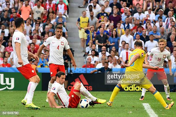 Ukraine's forward Roman Zozulya vies for the ball with Poland's midfielder Grzegorz Krychowiak during the Euro 2016 group C football match between...