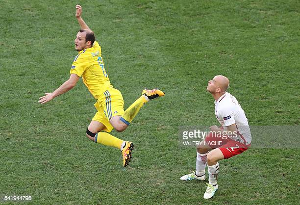 Ukraine's forward Roman Zozulya vies with Poland's defender Michal Pazdan during the Euro 2016 group C football match between Ukraine and Poland at...