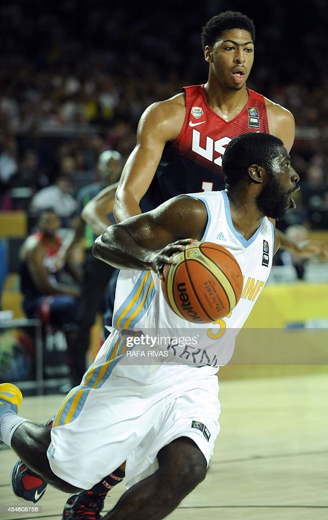 Ukraine's guard Eugene 'Pooh' Jeter vies with US centre Anthony Davis during the 2014 FIBA World basketball championships group C match Ukraine vs...