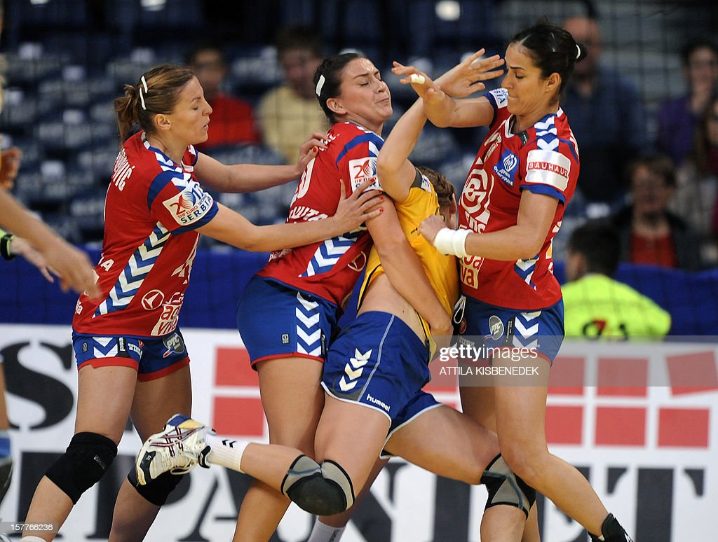 Ukraine's Iryna Sheyenko (2ndR) vies with Serbia's defenders during the 2012 EHF European Women's Handball Championship match between their teams on December 6, 2012, at the Kombank Arena of Belgrade. The Serbian capital Belgrade hosts the preliminary round Group A matches including Czech Republic, Norway, Serbia and Ukraine.
