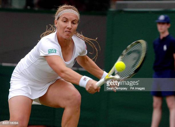 Ukraine's Julia Vakulenko in action against Russia's Svetlana Kuznetsova during The All England Lawn Tennis Championship at Wimbledon