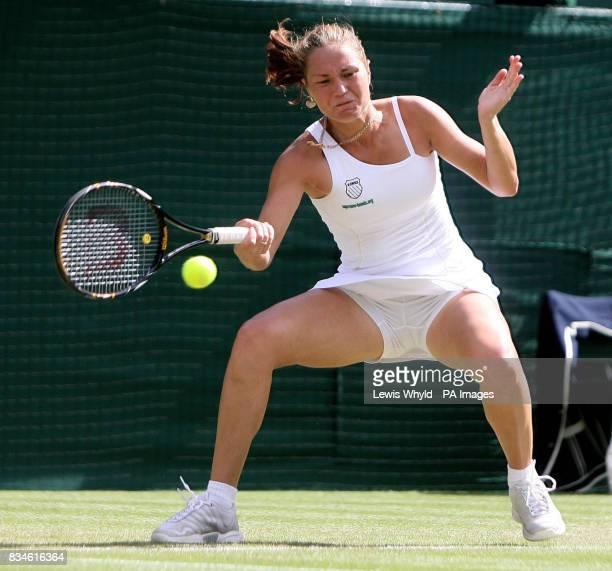 Ukraine's Kateryna Bondarenko in action against Russia's Svetlana Kuznetsova during The Wimbledon Championships at The All England Lawn Tennis Club...