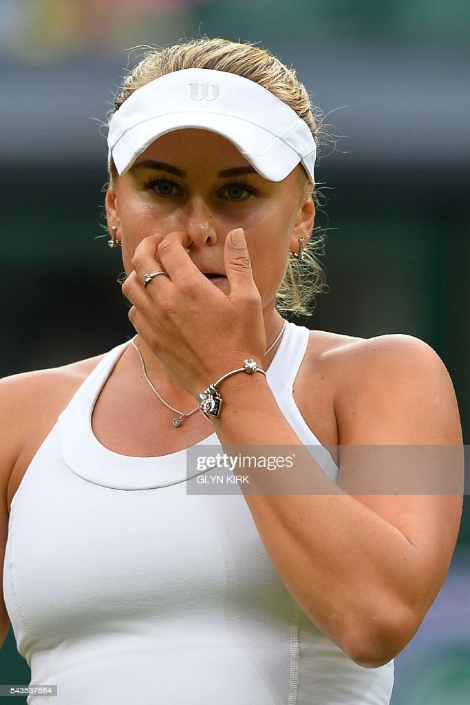 Ukraine's Kateryna Kozlova reacts after a point against Poland's Agnieszka Radwanska during their women's singles first round match on the third day of the 2016 Wimbledon Championships at The All England Lawn Tennis Club in Wimbledon, southwest London, on June 29, 2016. / AFP / GLYN