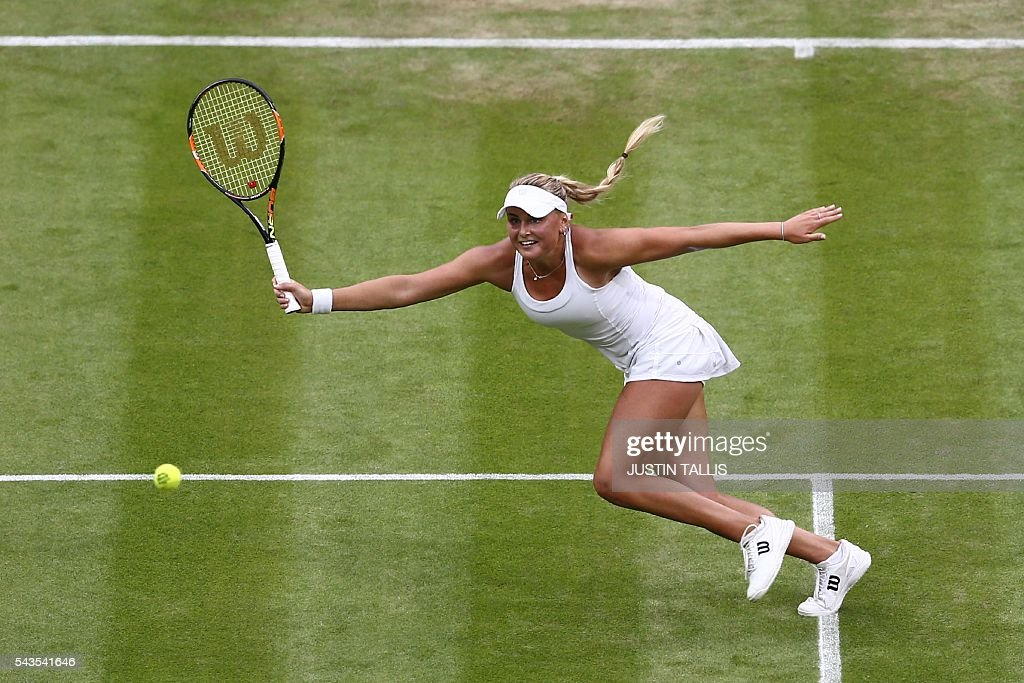 Ukraine's Kateryna Kozlova returns against Poland's Agnieszka Radwanska during their women's singles first round match on the third day of the 2016 Wimbledon Championships at The All England Lawn Tennis Club in Wimbledon, southwest London, on June 29, 2016. / AFP / JUSTIN