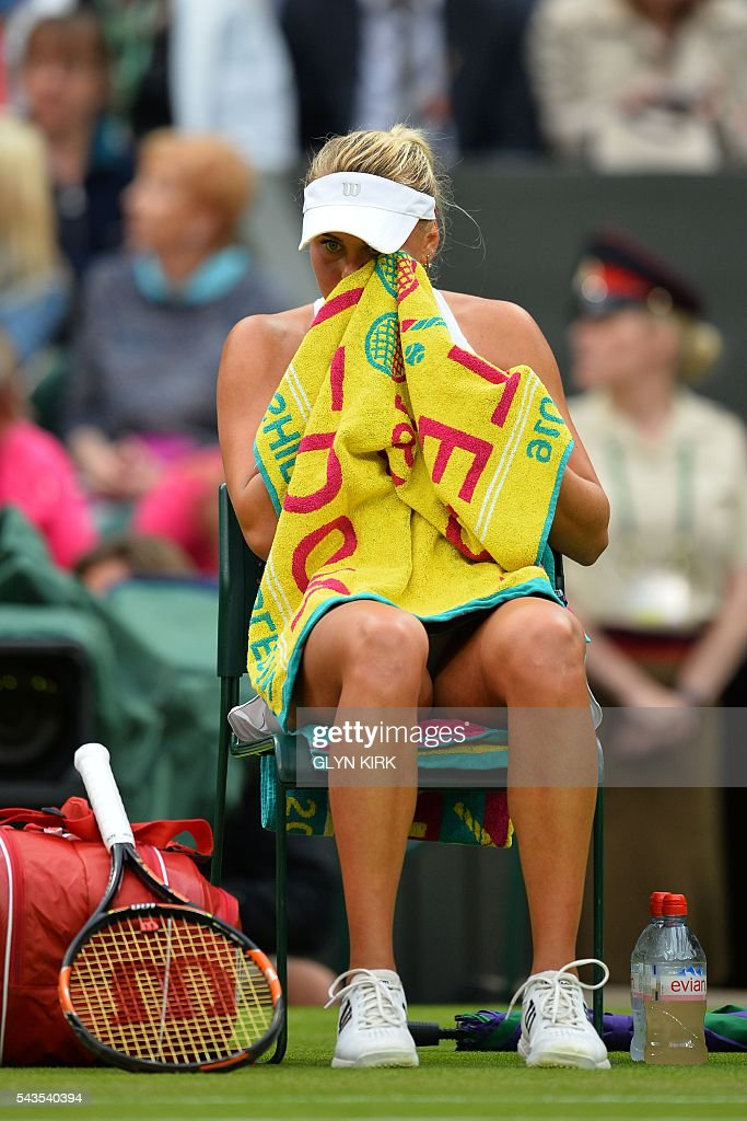 Ukraine's Kateryna Kozlova sits in the break between games during their women's singles first round match on the third day of the 2016 Wimbledon Championships at The All England Lawn Tennis Club in Wimbledon, southwest London, on June 29, 2016. / AFP / GLYN