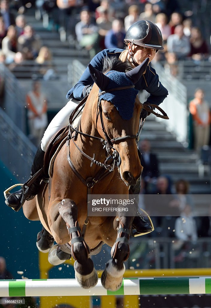 Ukraine's Katharina Offel riding Cathleen competes in the International Jumping Competition 'Grand Prix Hermes' on April 14, 2013, at the Grand Palais in Paris.