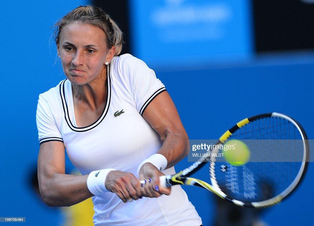 Ukraine's Lesia Tsurenko hits a return against Denmark's Caroline Wozniacki during their women's singles match on day six of the Australian Open tennis tournament in Melbourne on January 19, 2013.