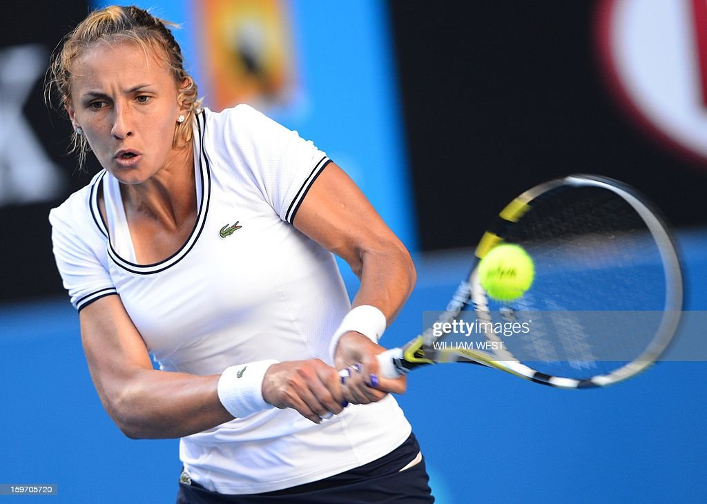 Ukraine's Lesia Tsurenko hits a return against Denmark's Caroline Wozniacki during their women's singles match on day six of the Australian Open tennis tournament in Melbourne on January 19, 2013.