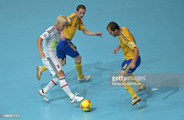 Ukraine's Maksym Pavlenko defends against Japan's Kaoru Morioka during quarter finals in the FIFA Futsal World Cup 2012 at the Huamark Indoor Stadium...