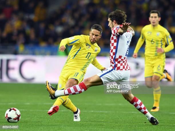 Ukraine's Marlos vies with Croatia's Sime Vrsaljko during the FIFA World Cup 2018 qualification football match between Ukraine and Croatia in Kiev on...