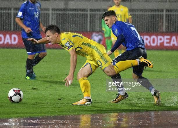 Ukraine's midfielder Yevhen Konoplyanka fights for the ball with Kosovo's midfielder Milot Rashica during the FIFA World Cup 2018 qualification...