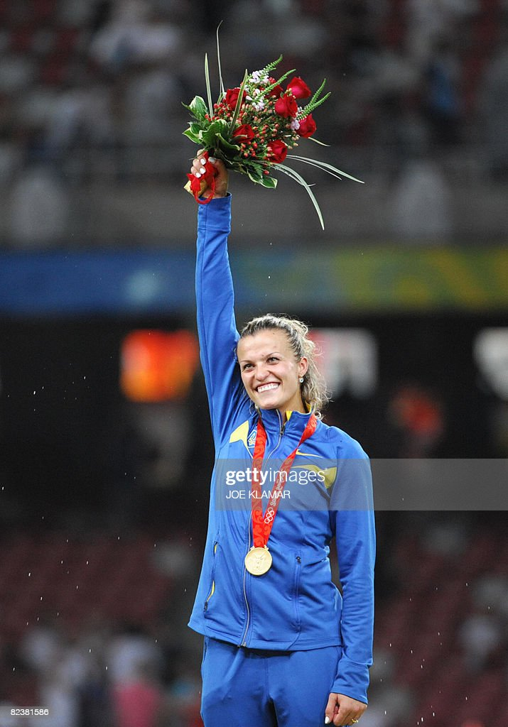 Ukraine's Nataliia Dobrynska celebrates on the podium after winning the women's Heptathlon at the National stadium as part of the 2008 Beijing Olympic Games on August 16, 2008. Ukraine's Nataliia Dobrynska won ahead of fellow countrywoman Lyudmila Blonska and Hyleas Fountain the US.