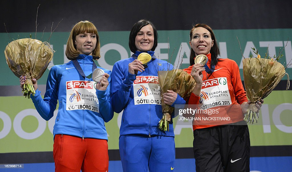 Ukraine's Nataliya Lupu (C) celebrates winning the women's 800m final on the podium with 2nd place Russia's Yelena Kotulskaya (L) and 3rd place Belarus' Marina Arzamasova at the European Indoor athletics Championships in Gothenburg, Sweden, on March 3, 2013. AFP PHOTO / JONATHAN NACKSTRAND