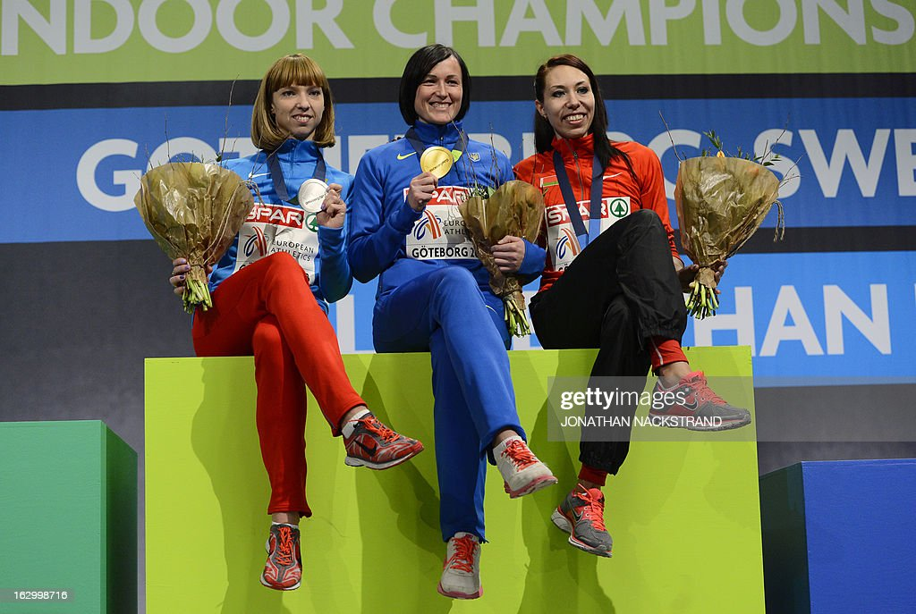 Ukraine's Nataliya Lupu (C) celebrates winning the women's 800m final on the podium with 2nd place Russia's Yelena Kotulskaya (L) and 3rd place Belarus' Marina Arzamasova at the European Indoor athletics Championships in Gothenburg, Sweden, on March 3, 2013.