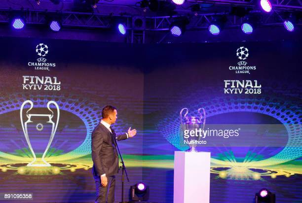 Ukraine's national soccer team coach Andriy Shevchenko speaks next to the UEFA Champions League trophy during the presentation of the logo of the...